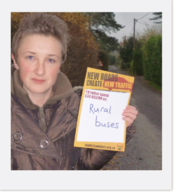 Campaigner with 'rural buses' sign