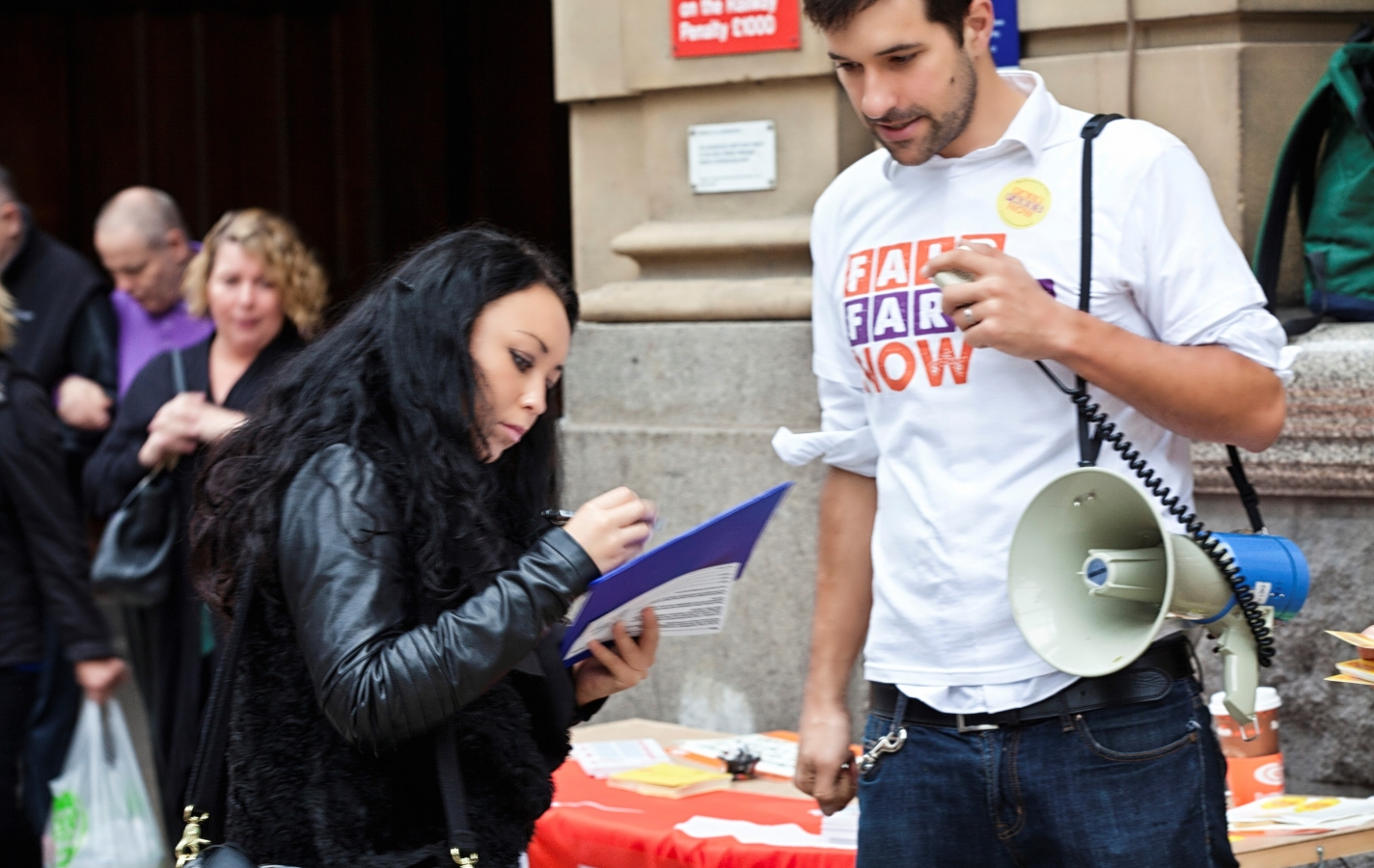 No Northern Fares Hike: petition signing at Manchester Victoria station. Photography: Adam Spencer Young.