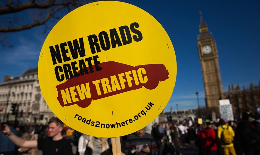 Photo: Placard saying 'New Roads Create New Traffic'