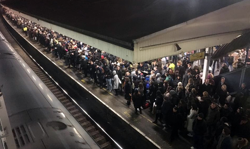 Photo: commuters at crowded station