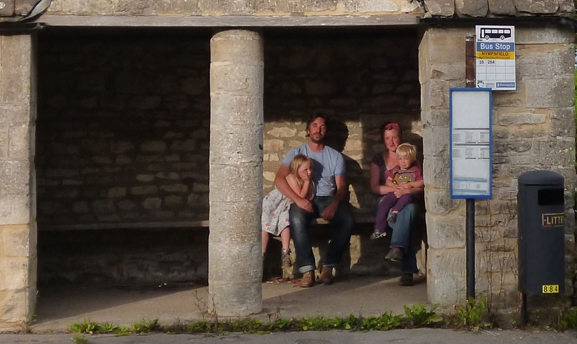 Family at bus stop in Gloucestershire