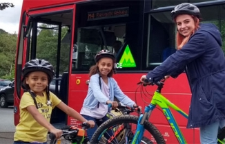 Photo courtesy of Moorsbus showing young cyclists and a bus