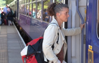 Woman boarding train