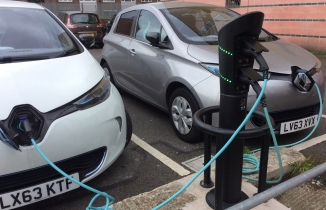 Electric cars charging in car park