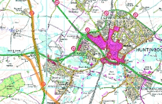 Map of road plans and air quality management areas around Huntingdon