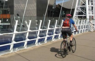 cyclist at media city, salford