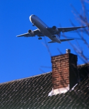 Plane flying over a house