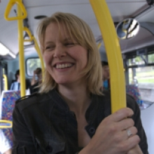Smiling woman on bus