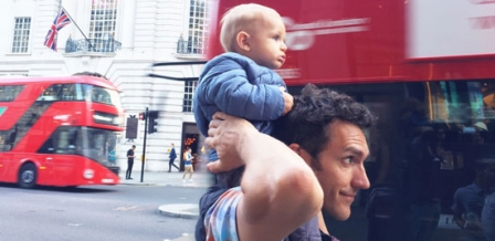 Photo: man and child with buses